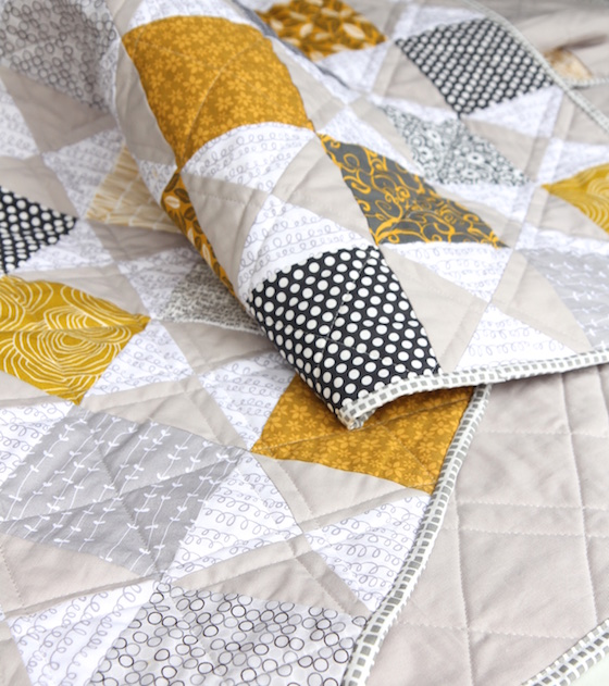 mustard and gray quilt