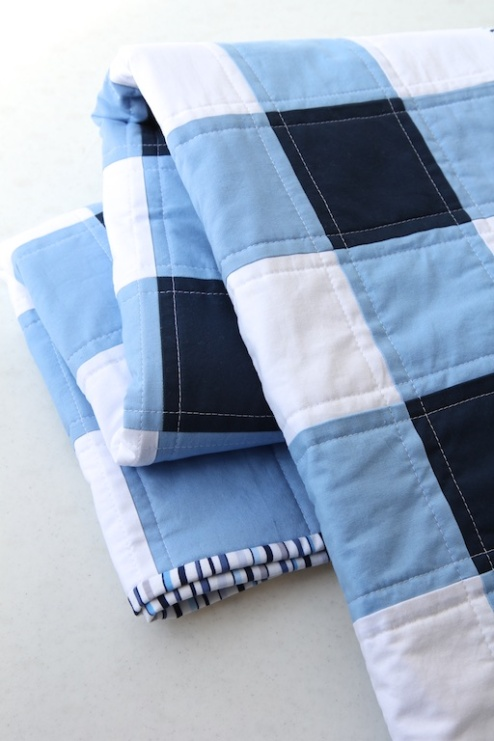 Navy & White Gigham Quilt folded